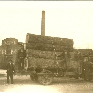 Nice Poplar veneer logs,  George Gramelspacher on ground at left.  The loggers are not known.
